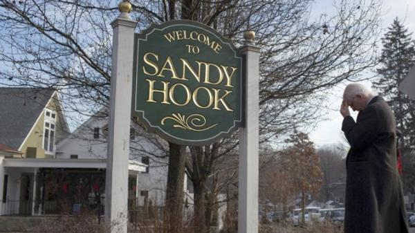 sandyhook-sign-man-Web600w