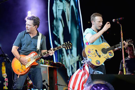 "Michael J. Fox and Chris Martin perform ""Johnny Be Good.""​"