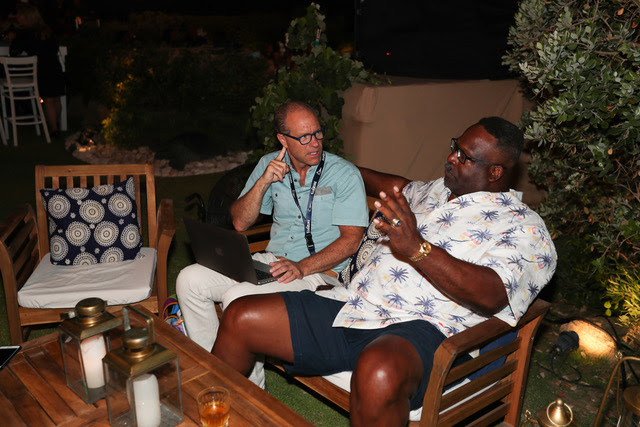 Jeff Benedict with Andre Tippett in Israel.